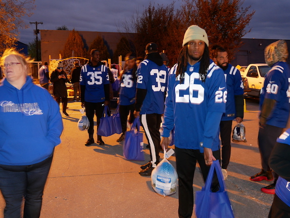 Indianapolis Colts players distribute Thanksgiving groceries